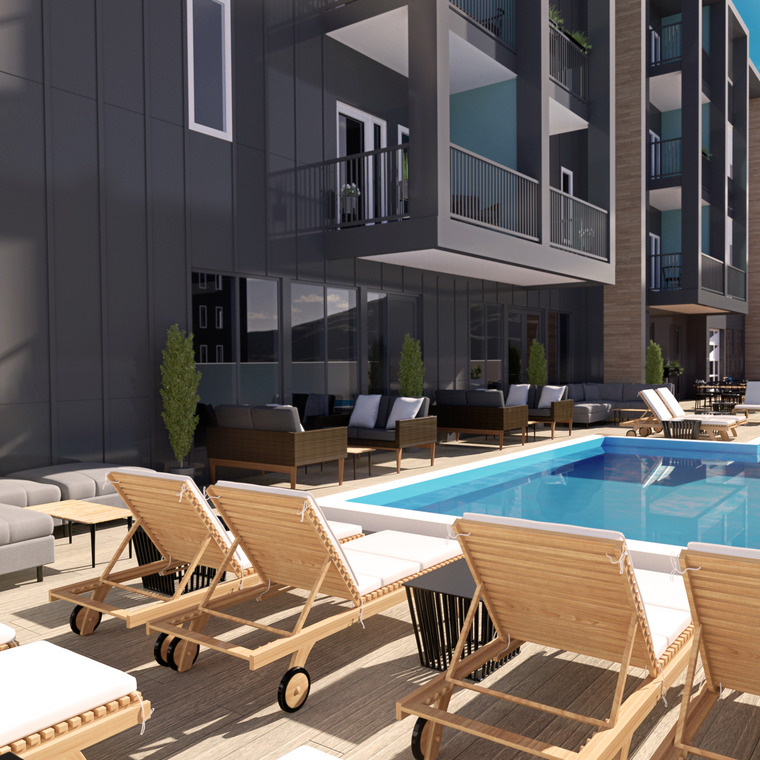 Outdoor Community Pool With Lounge Chairs